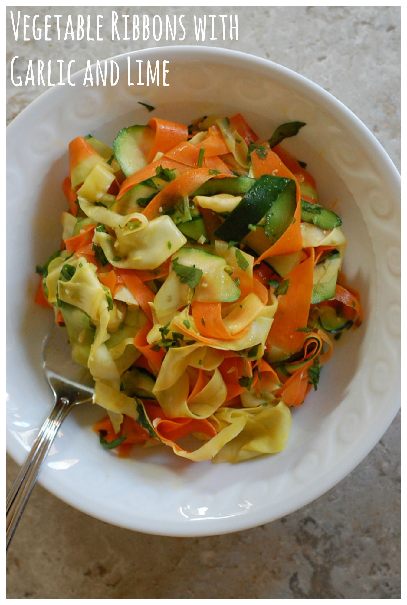 Ribbons of carrots, squash, and zucchini are quickly sauteed with olive oil, garlic, and red pepper flakes for an easy, vegan, and gluten-free weeknight side!